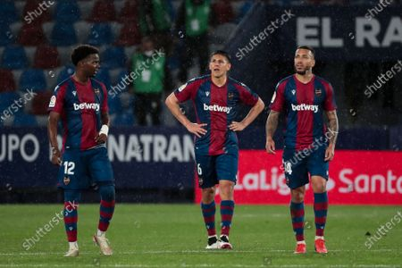 Levante's defender Mickael  Ramon Malsa (L) Levante's defender Oscar Duarte (C) and Levante's forward Ruben Vezo (R) after  spanish La Liga match between Levante UD  and  Sevilla  FC  at Ciutat de Valencia  Stadium on April 21, 2021.