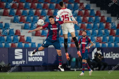 Levante's defender Oscar Duarte (L) and  Youssef En-Nesyri  of Sevilla FC during  spanish La Liga match between Levante UD  and  Sevilla  FC  at Ciutat de Valencia  Stadium on April 21, 2021.