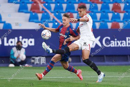 Dani Gomez of Levante UD and Diego Carlos Santos Silva of Sevilla