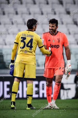 Juventus goalkeeper Gianluigi Buffon (77) hugs Parma goalkeeper Simone Colombi (34) during the Serie A football match n.32 JUVENTUS - PARMA on April 21, 2021 at the Allianz Stadium in Turin, Piedmont, Italy. Final result: Juventus-Parma 3-1. Sporting stadiums around Italy remain under strict restrictions due to the Coronavirus Pandemic as Government social distancing laws prohibit fans inside venues resulting in games being played behind closed doors.
