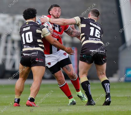 Stock Picture of Oliver Roberts of Salford Red Devils tries to run through Mark Loane of Leigh Centurions and  Alex Gerrard of Leigh Centurions
