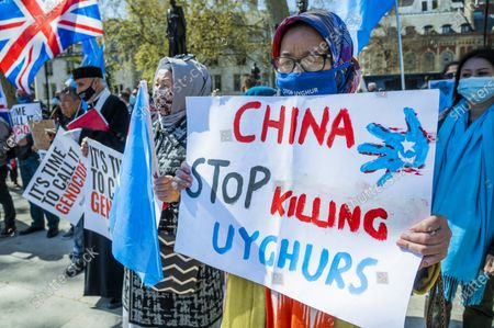 """Its time to call it Genocide - Nusrat Ghani, a Conservative MP, is leading a debate in the chamber on the motion """"That this House believes that Uyghurs and other ethnic and religious minorities in the Xinjiang Uyghur Autonomous Region are suffering Crimes Against Humanity and Genocide. And calls upon the Government to act to fulfil their obligations under the Convention on the Prevention and Punishment of Genocide and all relevant instruments of international law to bring it to an end."""" Protest outside Parliament in support of Uyghur Muslims, on the day that a motion of support is debated inside. It is against their treatment by China."""