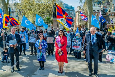 """Ian Duncan Smith MP (pictured) lends his support along with other MP's - Nusrat Ghani (pictured), a Conservative MP, is leading a debate in the chamber on the motion """"That this House believes that Uyghurs and other ethnic and religious minorities in the Xinjiang Uyghur Autonomous Region are suffering Crimes Against Humanity and Genocide. And calls upon the Government to act to fulfil their obligations under the Convention on the Prevention and Punishment of Genocide and all relevant instruments of international law to bring it to an end."""" Protest outside Parliament in support of Uyghur Muslims, on the day that a motion of support is debated inside. It is against their treatment by China."""