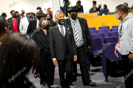 Rev. Al Sharpton, is followed by Katie and Aubrey Wright, parents of Daunte Wright, during funeral services of Daunte Wright at Shiloh Temple International Ministries in Minneapolis, . Wright, 20, was fatally shot by a Brooklyn Center, Minn., police officer during a traffic stop