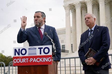 Sen. Lindsey Graham, R-S.C., right, listens as Sen. Ted Cruz, R-Texas, left, speaks during a news conference outside the Supreme Court in Washington