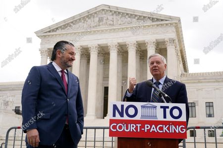 Sen. Lindsey Graham, R-S.C., right, speaks as Sen. Ted Cruz, R-Texas, left, listens during a news conference outside the Supreme Court in Washington