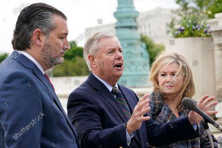 Sen. Lindsey Graham, R-S.C., center, speaks during a news conference with Sen. Ted Cruz, R-Texas, left, and Sen. Marsha Blackburn, R-Tenn., right, outside the Supreme Court in Washington