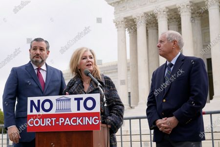 Sen. Marsha Blackburn, R-Tenn., center, standing with Sen. Ted Cruz, R-Texas, left, and Sen. Lindsey Graham, R-S.C., right, speaks during a news conference outside the Supreme Court in Washington