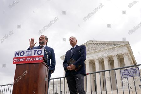 Sen. Ted Cruz, R-Texas, left, speaks as Sen. Lindsey Graham, R-S.C., right, listens during a news conference outside the Supreme Court in Washington