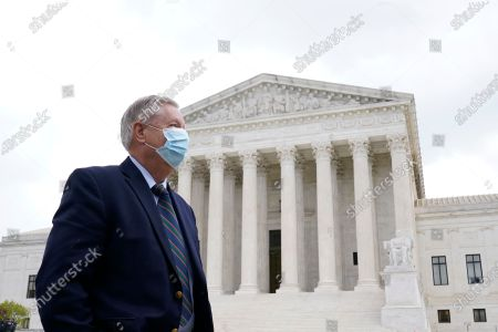 Sen. Lindsey Graham, waits for the start of a news conference outside the Supreme Court in Washington