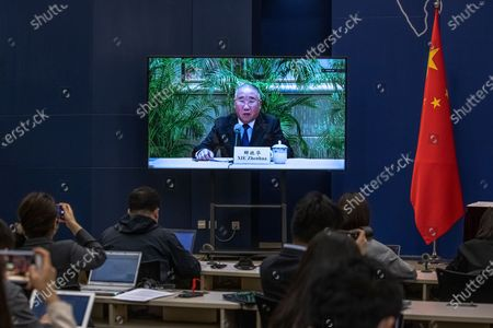 A screen shows Xie Zhenhua, China's Special Envoy for Climate Change, speaking during a media briefing on Chinese President Xi Jinping's attendance at virtual international Leaders Summit on Climate, at the Ministry of Foreign Affairs, in Beijing, China, 22 April 2021.  Around 40 international leaders attended the summit called by US President Biden. The meeting is intended to underline the urgency and economic benefits of stronger climate action on the road to the United Nations Climate Change Conference (COP26) in Glasgow in November 2021.