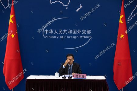 Ma Zhaoxu, a Chinese vice-minister of Foreign Affairs, speaks during a media briefing on Chinese President Xi Jinping's attendance at virtual international Leaders Summit on Climate, at the Ministry of Foreign Affairs, in Beijing, China, 22 April 2021. Around 40 international leaders attended the summit called by US President Biden. The meeting is intended to underline the urgency and economic benefits of stronger climate action on the road to the United Nations Climate Change Conference (COP26) in Glasgow in November 2021.