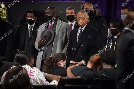Rev. Al Sharpton and Ben Crump stand with family members and community members at the public viewing service of Daunte Wright who was killed by a Brooklyn Center Police officer during the trail of former ex Minneapolis police officer Dereck Chauvin who was convicted for murdering George Floyd on Wednesday, April 21, 2021 in Minneapolis, MN. (Jason Armond / Los Angeles Times)