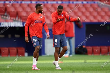 Moussa Dembele and Geoffrey Kondogbia of Atletico Madrid talk prior to the La Liga Santander match between Atletico de Madrid and SD Huesca at Estadio Wanda Metropolitano on April 22, 2021 in Madrid, Spain. Sporting stadiums around the Spain remain under strict restrictions due to the Coronavirus Pandemic as Government social distancing laws prohibit fans inside venues resulting in games being played behind closed doors.