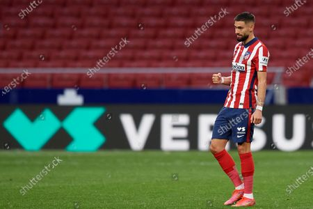 Yannick Carrasco of Atletico Madrid celebrates after scoring his sides first goal during the La Liga Santander match between Atletico de Madrid and SD Huesca at Estadio Wanda Metropolitano on April 22, 2021 in Madrid, Spain. Sporting stadiums around the Spain remain under strict restrictions due to the Coronavirus Pandemic as Government social distancing laws prohibit fans inside venues resulting in games being played behind closed doors.