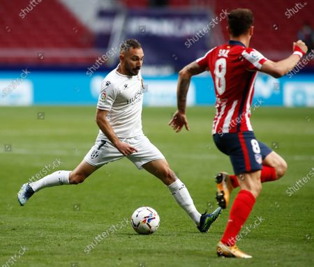 David Ferreiro of Huesca and Saul Niguez of Atletico de Madrid in action during the spanish league, La Liga, football match played between Atletico de Madrid and SD Huesca at Wanda Metropolitano stadium on April 22, 2021, in Madrid, Spain.
