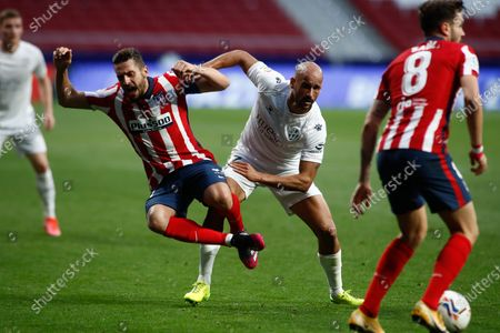 "Sandro Ramirez of Huesca and Jorge Resurreccion ""Koke"" of Atletico de Madrid in action during the spanish league, La Liga, football match played between Atletico de Madrid and SD Huesca at Wanda Metropolitano stadium on April 22, 2021, in Madrid, Spain."