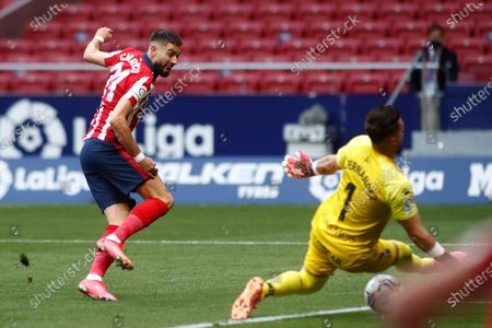 Yannick Carrasco of Atletico de Madrid and Alvaro Fernandez of Huesca in action during the spanish league, La Liga, football match played between Atletico de Madrid and SD Huesca at Wanda Metropolitano stadium on April 22, 2021, in Madrid, Spain.