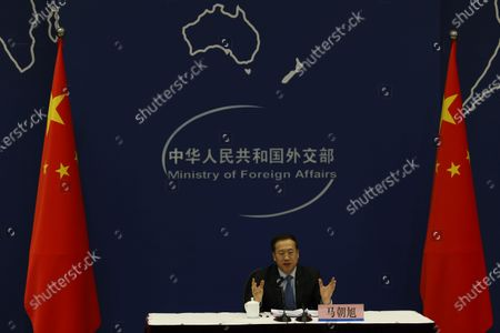 Stock Image of Ma Zhaoxu, Chinese Vice Minister of Foreign Affairs, talks about the Chinese President's attendance of the Leaders Summit on Climate during a press briefing at the Chinese Foreign Ministry in Beijing on . U.S. President Joe Biden convened leaders of the world's most powerful countries on Thursday to try to spur global efforts against climate change, drawing commitments from Chinese President Xi Jinping and Russian President Vladimir Putin to cooperate on cutting emissions despite their own sharp rivalries with the United States