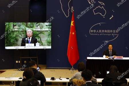 Ma Zhaoxu, Chinese Vice Minister of Foreign Affairs, at right talks about the Chinese President's attendance of the Leaders Summit on Climate during a press briefing with Xie Zhenhua, China's Special Envoy for Climate Change, on a video call at the Chinese Foreign Ministry in Beijing on . U.S. President Joe Biden convened leaders of the world's most powerful countries on Thursday to try to spur global efforts against climate change, drawing commitments from Chinese President Xi Jinping and Russian President Vladimir Putin to cooperate on cutting emissions despite their own sharp rivalries with the United States