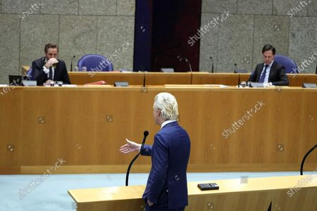 Outgoing Dutch Prime Minister Mark Rutte (R) and Health, Welfare and Sport Minister Hugo de Jonge (L) listen to Geert Wilders (PVV) (C) in the Lower House during a debate about the developments surrounding the coronavirus pandemic In The Hague, the Netherlands, 22 April 2021.