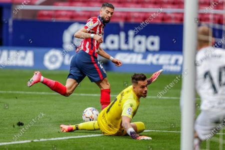 Atletico Madrid's Yannick Carrasco, left, tries to score during the Spanish La Liga soccer match between Atletico Madrid and Huesca at the Wanda Metropolitano stadium in Madrid, Spain