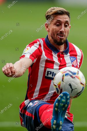 Atletico Madrid's Hector Herrera controls the ball during the Spanish La Liga soccer match between Atletico Madrid and Huesca at the Wanda Metropolitano stadium in Madrid, Spain