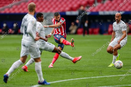Atletico Madrid's Yannick Carrasco tries a shoot during the Spanish La Liga soccer match between Atletico Madrid and Huesca at the Wanda Metropolitano stadium in Madrid, Spain