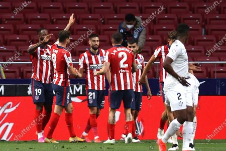 Atletico's winger Yannick Ferreira Carrasco (C) celebrates with his teammates after scoring the 2-0 lead during the Spanish LaLiga soccer match between Atletico de Madrid and SD Huesca at Wanda Metropolitano stadium in Madrid, Spain, 22 April 2021.