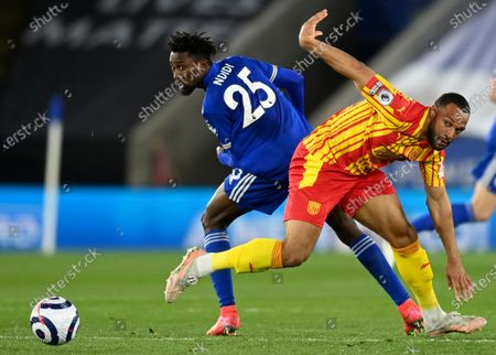 Leicester's Wilfred Ndidi, left, duels for the ball with West Bromwich Albion's Matt Phillips during the English Premier League soccer match between Leicester City and West Bromwich Albion at the King Power Stadium in Leicester, England