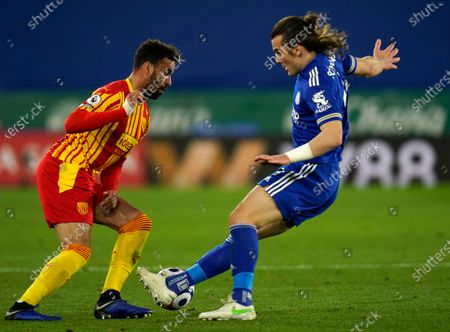 West Bromwich Albion's Hal Robson-Kanu, left, duels for the ball with Leicester's Caglar Soyuncu during the English Premier League soccer match between Leicester City and West Bromwich Albion at the King Power Stadium in Leicester, England