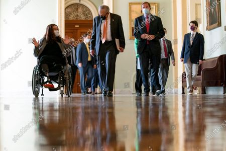 Senate Majority Leader Chuck Schumer of N.Y., center, Sen. Tammy Duckworth, D-Ill., left, and Sen. Richard Blumenthal, D-Conn., right, speak as they walk to a news conference after the Senate passes a COVID-19 Hate Crimes Act on Capitol Hill, in Washington