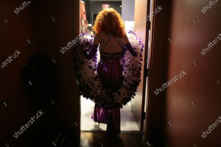 Stock Image of Tempest Storm, an 80-year-old burlesque dancer, heads to the stage to perform at the Burlesque Hall of Fame's annual All-Star Burlesque Weekend held at the Palms hotel and casino in Las Vegas. Tempest Storm, the legendary burlesque star who blazed a trail for strip-tease artists for more than a half-century, died, at her Las Vegas apartment, her longtime friend, confidant and business partner Harvey Robbins, told the Las Vegas Review-Journal. She was 93