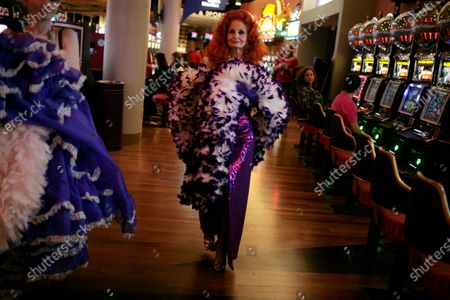 Tempest Storm, an 80-year-old burlesque dancer, walks through the casino area to perform at the Burlesque Hall of Fame's annual All-Star Burlesque Weekend held at the Palms hotel and casino in Las Vegas. Tempest Storm, the legendary burlesque star who blazed a trail for strip-tease artists for more than a half-century, died, at her Las Vegas apartment, her longtime friend, confidant and business partner Harvey Robbins, told the Las Vegas Review-Journal. She was 93