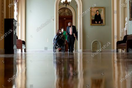 Senate Majority Leader Chuck Schumer of N.Y., right, Sen. Mazie Hirono, D-Hawaii, center, and Sen. Tammy Duckworth, D-Ill., left, speak as they walk to a news conference after the Senate passes a COVID-19 Hate Crimes Act on Capitol Hill, in Washington