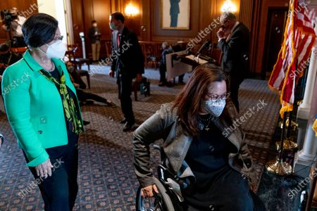 Senate Majority Leader Chuck Schumer of N.Y., top right, Sen. Mazie Hirono, D-Hawaii, left, Sen. Tammy Duckworth, D-Ill., bottom right, and Sen. Richard Blumenthal, D-Conn., second from left, leave a news conference after the Senate passes a COVID-19 Hate Crimes Act on Capitol Hill, in Washington