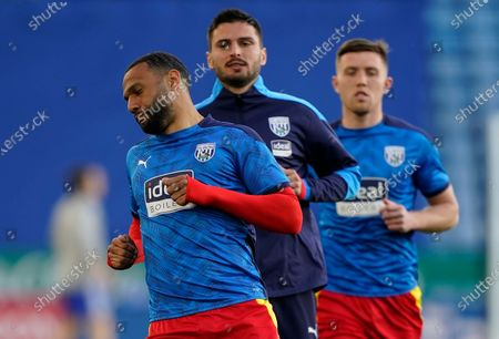 West Bromwich Albion's Matt Phillips (L) leads the warming up for the English Premier League soccer match between Leicester City and West Bromwich Albion in Leicester, Britain, 22 April 2021.