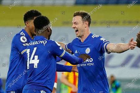 Leicester's Jonny Evans (R) celebrates with team-mates after scoring the 2-0 goal during the English Premier League soccer match between Leicester City and West Bromwich Albion in Leicester, Britain, 22 April 2021.