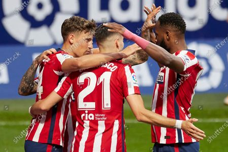 Marcos Llorente and Yannick Carrasco and Moussa Dembele of Atletico de Madrid