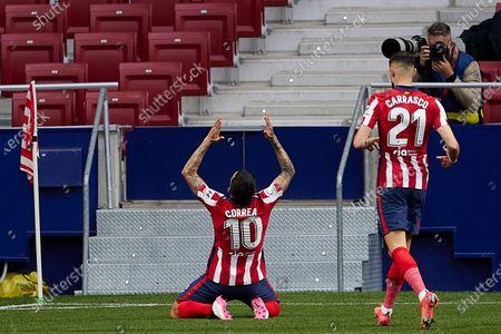 Angel Correa and Yannick Carrasco of Atletico de Madrid celebrating goal