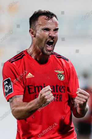 Benfica player Haris Seferovic celebrates after scoring a goal during the Portuguese First League soccer match between Portimonense and Benfica held at Municipal de Portimao stadium in Portimao, Portugal, 22 April 2021.