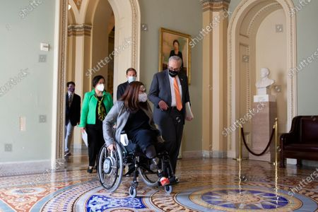 Senate Majority Leader Chuck Schumer (R), Democratic Senator from Illinois Tammy Duckworth (Front L), Democratic Senator from Hawaii Mazie Hirono (Back L) and Democratic Senator from Connecticut Richard Blumenthal (Back R) walk to a news conference after the Senate passed the COVID-19 Hate Crimes Act, on Capitol Hill in Washington, DC, USA, 22 April 2021. The legislation was crafted in response to an uptick in hate crimes against Asians in the US.