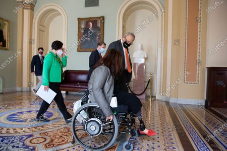 Senate Majority Leader Chuck Schumer (R), Democratic Senator from Illinois Tammy Duckworth (Front), Democratic Senator from Hawaii Mazie Hirono (Back L) and Democratic Senator from Connecticut Richard Blumenthal (Back R) walk to a news conference after the Senate passed the COVID-19 Hate Crimes Act, on Capitol Hill in Washington, DC, USA, 22 April 2021. The legislation was crafted in response to an uptick in hate crimes against Asians in the US.