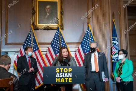 United States Senator Tammy Duckworth (Democrat of Illinois), second from left, is joined by United States Senator Richard Blumenthal (Democrat of Connecticut), left, United States Senate Majority Leader Chuck Schumer (Democrat of New York), second from right, and United States Senator Mazie Hirono (Democrat of Hawaii), right, during a press conference following Senate passage of the COVID-19 Hate Crimes Act at the US Capitol in Washington, DC,.