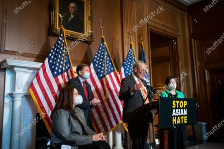United States Senate Majority Leader Chuck Schumer (Democrat of New York), second from right, is joined by United States Senator Tammy Duckworth (Democrat of Illinois), left, United States Senator Richard Blumenthal (Democrat of Connecticut), second from left, and United States Senator Mazie Hirono (Democrat of Hawaii), right, during a press conference following Senate passage of the COVID-19 Hate Crimes Act at the US Capitol in Washington, DC,.