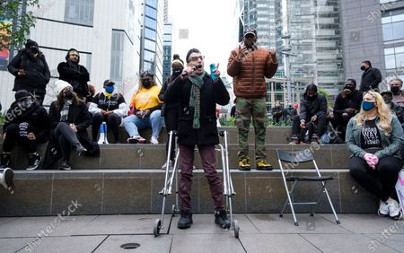 Actor Ryan J. Haddad (C), who has cerebral palsy, speaks during a theater community rally and a 'March on Broadway', organized partly in response to workplace abuse allegations against Broadway producer Scott Rudin, in New York, New York, USA, 22 April 2021. Organizers of the march called for Rudin to be effectively removed from producing Broadway shows as well as called for greater accountability and diversity in theater workplaces as ways to protect the rights and opportunities of people of differing races, gender identity, and disabilities.