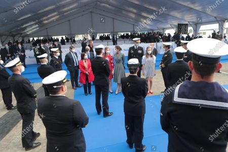 """Stock Image of King Felipe VI of Spain and Queen Letizia of Spain accompanied by their daughters the Princess of Asturias Leonor and the Princess Sofía arrived at the Navantia shipyard facilities in Cartagena, where they discovered a plaque commemorating the sight and talked with the workers participating in the construction of Submarine S-81 """" Isaac Peral """". Princess of Asturias Leonor bless the launch of the submarine"""