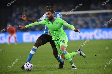Mohamed Fares of SS Lazio competes for the ball with Tiemoue Bakayoko of SSC Napoli during the Serie A match between SSC Napoli and SS Lazio at Stadio Diego Armando Maradona Naples Italy on 22 April 2021.