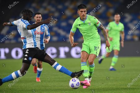 Stock Picture of Joaquin Correa of SS Lazio competes for the ball with Tiemoue Bakayoko of SSC Napoli during the Serie A match between SSC Napoli and SS Lazio at Stadio Diego Armando Maradona Naples Italy on 22 April 2021.