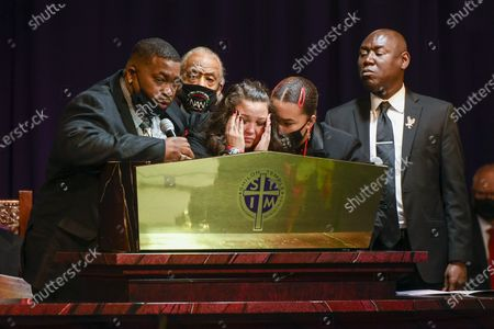 Stock Image of Daunte Wright's father Aubrey Wright (L) talks about his son as Wright's mother Katie Wright (C) become emotional as attorney Ben Crump (R) and Rev. Al Sharpton (2-L) look on during the funeral at Shiloh Temple International Ministries in Minneapolis, Minnesota, USA, 22 April 2021. On 11 April 2021, Daunte Demetrius Wright, 20, was fatally shot by police officer Kimberly Ann Potter in Brooklyn Center, Minnesota during a traffic stop.
